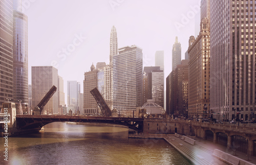 Photo The raising of the bridge on the Chicago River and sailboats move from their harbor on Lake Michigan