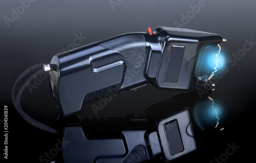 Fototapeta Electroshock black for defense against attack on a different background
