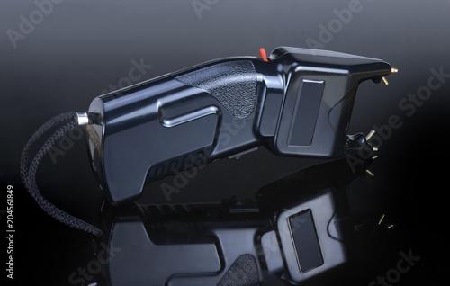 Fotografie, Obraz  Electroshock black for defense against attack on a different background