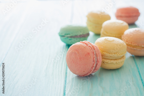 Staande foto Macarons Assortment of macarons on blue wood background
