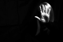 A Woman Hiding Her Face And Sh...