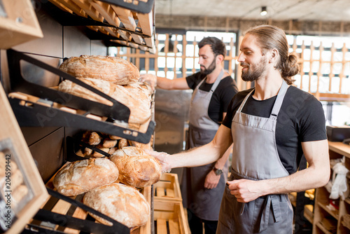 Sellers working in the bakery shop Canvas Print