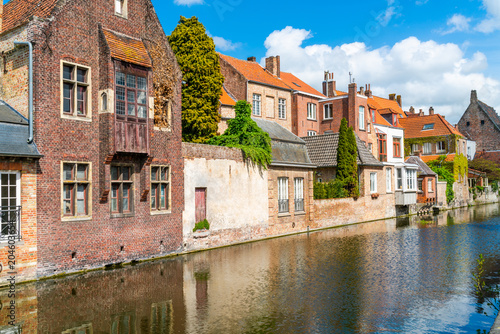 Wall Murals Bridges View of a canal and old colorful buildings in Bruges, Belgium