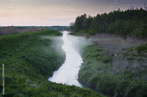 Foto op Canvas Rivier Rising fog over a small river