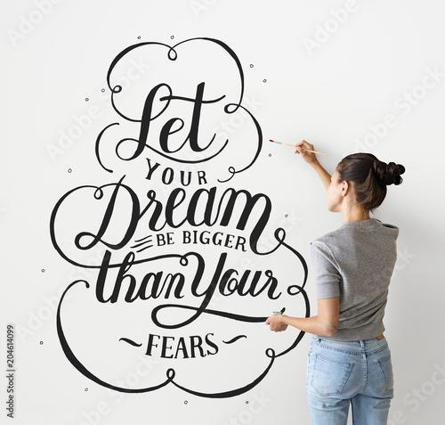 Photo sur Toile Positive Typography Female artist writing a life motivation quote on the wall