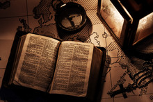 An Old Bible On A Wooden Table