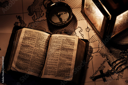 Fotografie, Obraz  An old bible on a wooden table