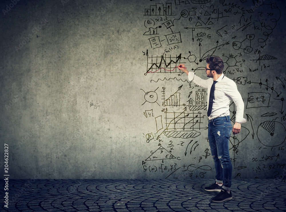 Fototapety, obrazy: Businessman standing and drawing business ideas