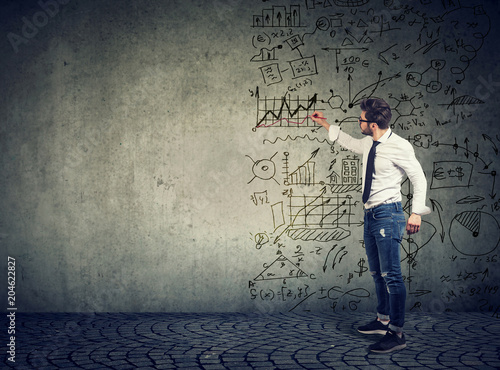 Fototapeta Businessman standing and drawing business ideas obraz