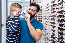 Happy Father And Son Choosing ...