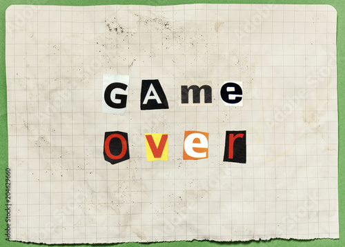 An anonymous letter with characters cut out from newspapers and magazines, composing the words Game Over (an ominous threat) Wallpaper Mural