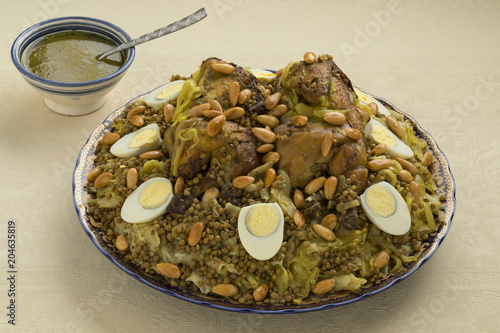 Traditional Moroccan Rfissa dish with eggs and almonds
