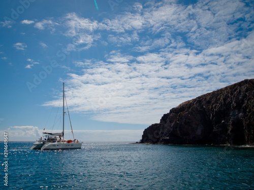 Tuinposter Canarische Eilanden Small private Yacht boat out at sea on the coast of Lanzarote