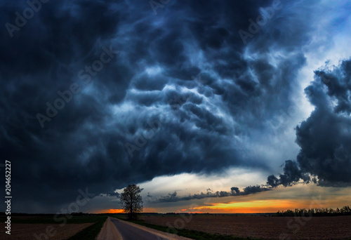 Fotografia Storm clouds with the rain