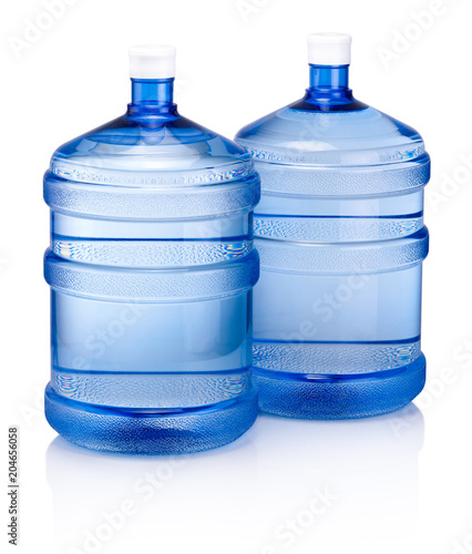 Fototapeta Two big blue plastic cooler bottle for potable water isolated on a white backgro