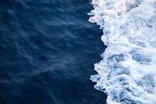 Blue Seawater With Sea Foam As...