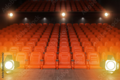 Foto op Aluminium Uitvoering View from the stage of concert hall or theater with red seats and spot light.