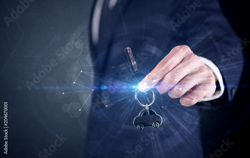 Foto op Aluminium Uitvoering Businessman in suit holding over a key with connection concept around
