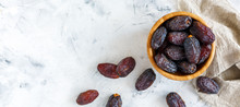 Delicious Dates In A Wooden Bowl.