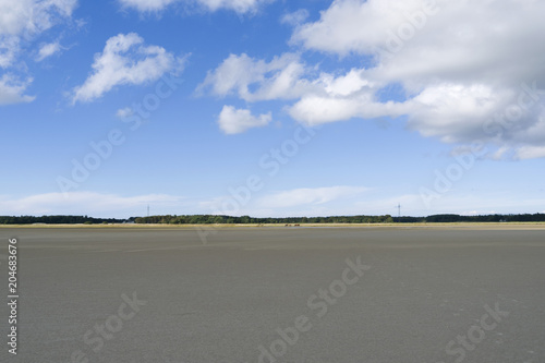 Deurstickers Kust Laesoe / Denmark: View from the dry fallen mudflat in the south of the Kattegat island to the coastline