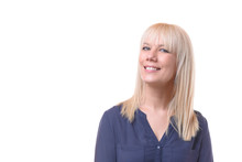 Smiling Blond Woman With Her Head Turned Away