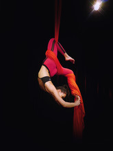 Aerial Silks Dancer In Red On Black Background