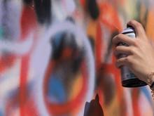 Hand Holding Aerosol Paint Wal...