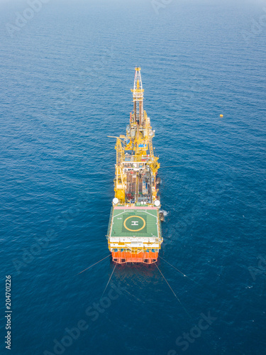 Aerial View of Tender Drilling Oil Rig (Barge Oil Rig) in The Middle