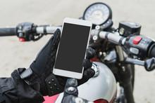 Biker Riding Motorbike And Holding Smart Phone