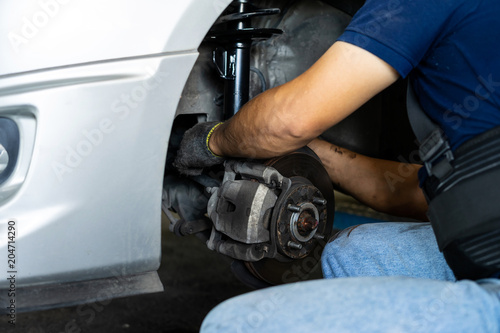 Photo Technicians changing new shock absorbers