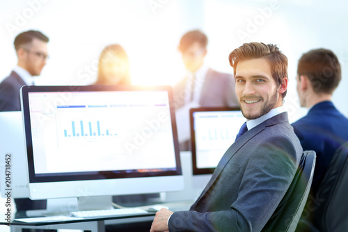 Fotobehang Stof Businessman analyzing economic graphs at office