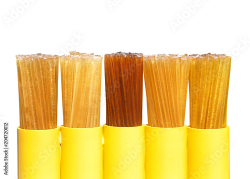 Fotografie, Obraz  Honey Straws in a display isolated on white