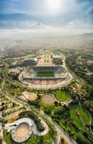 Foto op Aluminium Centraal Europa Barcelona aerial view, Anella Olimpica sport complex on the hill with city skyline , Spain. Sunbeam light
