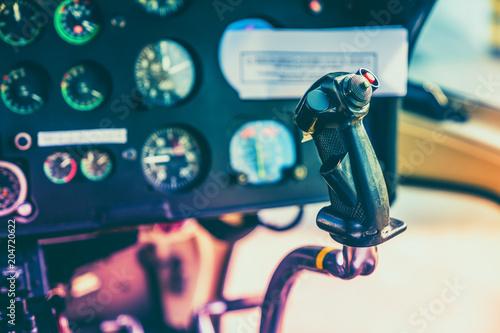 Avionics instrumentation panel on helicopter board. Vintage colors