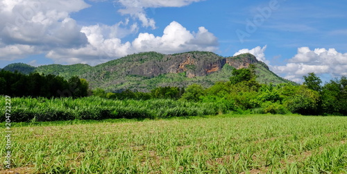 Foto op Canvas Pistache View of mountains, sky, green fields and streams on bright sunny days. Blue sky and beautiful clouds in bright days.