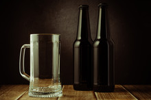 Empty Beer Mug And Bottle On A...