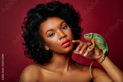 beautiful woman holding chameleon
