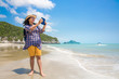 Tourist taking photo on the beach, Vacation concept