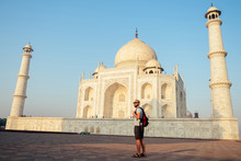 Young Man Tourist Looking To The Taj Mahal In Agra, India . Concept Of Culture, Tourism And Religion