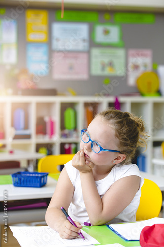 Fotografie, Obraz  Beautiful child thoughtful in school