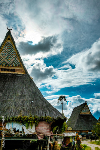 vertical view of traditional old batak people houses in lake toba in sumatra ind Canvas Print