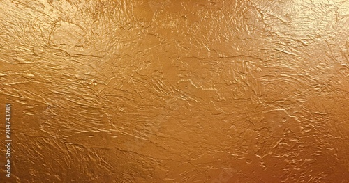 Fotografía  gold background paper, texture is old vintage distressed solid glitter gold color with rough peeling grunge paint on edges