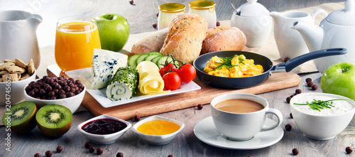 Fototapeta Breakfast served with coffee, cheese, cereals and scrambled eggs obraz