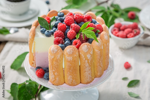 Deurstickers Dessert Closeup of yoghurt cake with biscuits and berries in summer