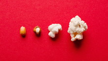 Stages Of Preparation Of Corn Kernels On Red Table, Top View