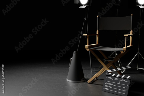 Photographie Director Chair,Megaphone,Movie Clapper and lighting equipment on dark background