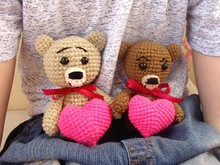 Two Knitted Bears With Valentine's Heart On The Boy's Hands