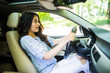 Young frightened driver woman squealing brakes avoiding an accident. Shocked girl tooting horn