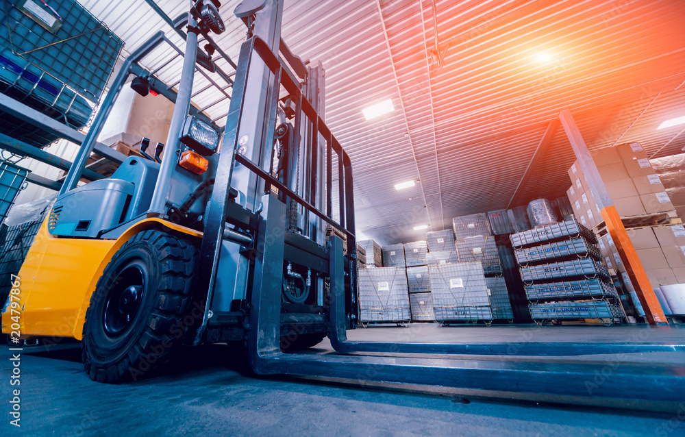 Fototapety, obrazy: Forklift loader. Pallet stacker truck equipment at warehouse