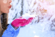 Woman Blowing Snow On Sunny Fr...